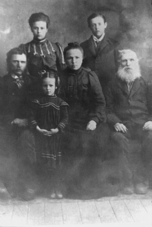 Stevenson Family in 1909 Back row: Bertha Amelia Stevenson (First Married to John Nelson and then to George Elwood Smith), George Edward Stevenson, Middle Row: George Perry Stevenson, Susan Evalena Stevenson, Isaac Stevenson, Front: Eliza Mae Stevenson,Note Eliza Mae Stevenson (first married to Henry Smith and then Richard A Wilder) Eliza Mae Stevenson ~ age about 6 years old at the time when we came from our home in Kansas and Daddy bought our home in Swans trail between Everett and Snohomish Washington. We had 20 acres there a big house and fine orchard.